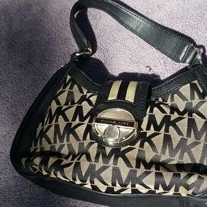 Michael Kors black and tan mk buckle satchel